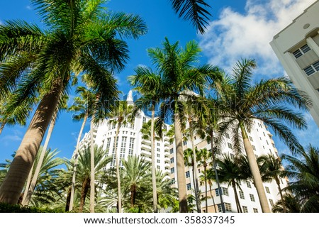 Beautiful Miami Beach cityscape with art deco architecture and palm trees. - stock photo