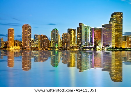 Beautiful Miami Florida skyline at dusk with lights and reflections on Bay - stock photo