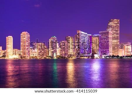 Beautiful Miami Florida skyline with lights and bay - stock photo