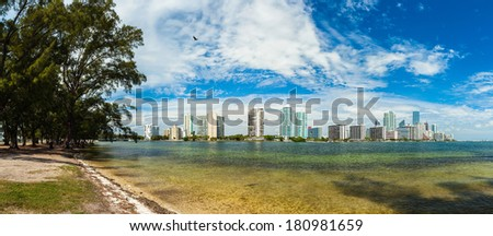 Beautiful Miami panorama skyline along Biscayne Bay with tall Brickell Avenue condos. - stock photo