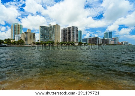 Beautiful Miami skyline along Biscayne Bay from Key Biscayne with tall Brickell Avenue condos in the background. - stock photo