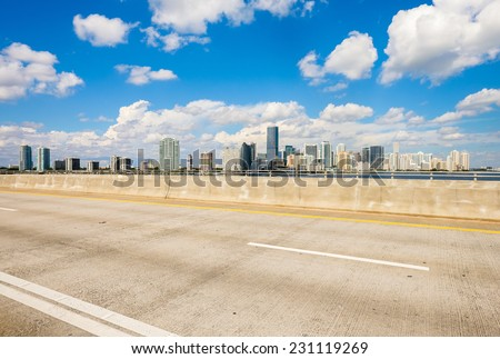 Beautiful Miami skyline along Biscayne Bay viewed from the Rickenbacker Causeway Bridge. - stock photo