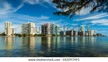 Beautiful Miami skyline along Biscayne Bay with tall Brickell Avenue condos. - stock photo