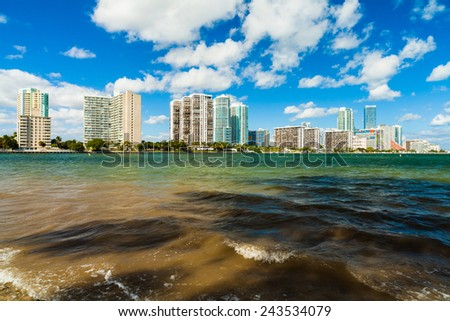 Beautiful Miami skyline along Biscayne Bay with tall Brickell Avenue condos and downtown office buildings. - stock photo