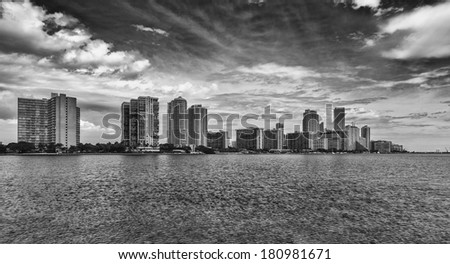 Beautiful Miami skyline along Biscayne Bay with tall Brickell Avenue condos in black and white. - stock photo