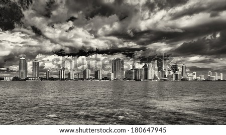 Beautiful Miami skyline along Biscayne Bay with tall Brickell Avenue condos in dramatic black and white. - stock photo