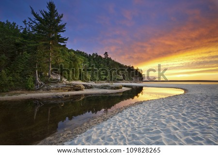 Beautiful Michigan Landscape. Image of Miners Beach at Pictured Rock National Lakeshore, Michigan, USA. - stock photo