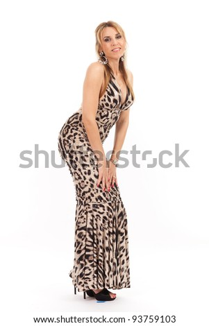 Beautiful middle age woman wearing a formal evening gown isolated on a white background.
