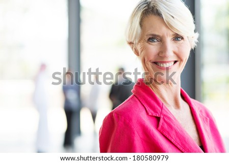 beautiful middle aged businesswoman in modern office - stock photo