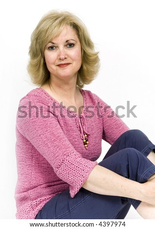 Beautiful middle-aged woman against a white background - stock photo