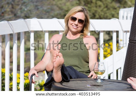 Beautiful middle-aged woman outside - stock photo