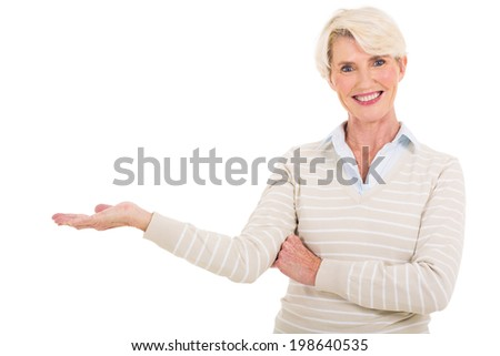 beautiful middle aged woman presenting on white background - stock photo