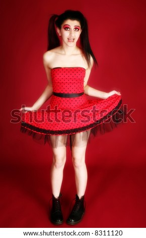 Beautiful middle easter woman dressed in artistic goth style over red background. - stock photo