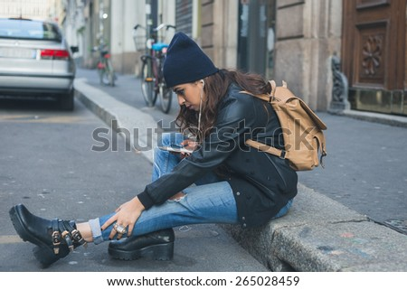 Beautiful Middle Eastern girl with long hair posing in an urban context