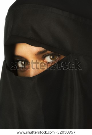 Beautiful Middle Eastern woman in niqab traditional veil - stock photo