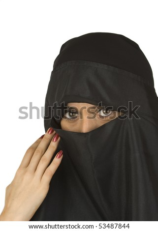 Beautiful Middle eastern woman in niqab traditional veil against a white background