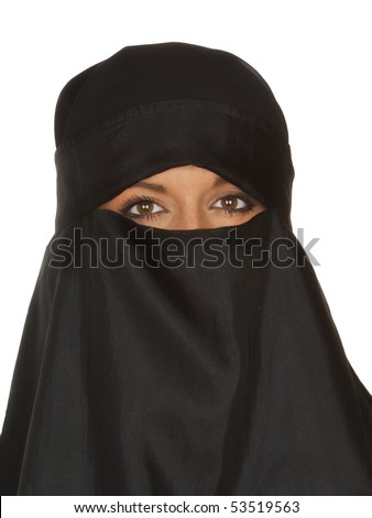 Beautiful Middle eastern woman in niqab traditional veil against a white background - stock photo