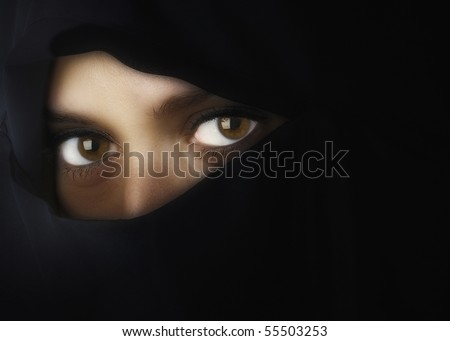 Beautiful Middle eastern woman in niqab traditional veil with glow filter effect - stock photo