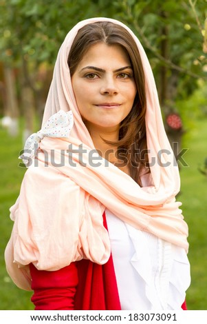 Beautiful middle eastern woman in pink scarf. - stock photo