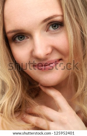 Beautiful middleaged woman with clear face isolated over background - stock photo