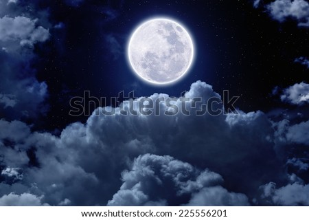 Beautiful midnight sky with bright full moon and stars above clouds