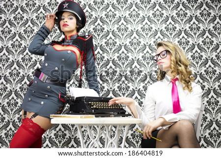 beautiful military boss and her sexy secretary - stock photo
