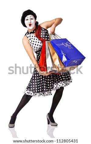 beautiful mime in spotty dress holding shopping bags. Isolated - stock photo
