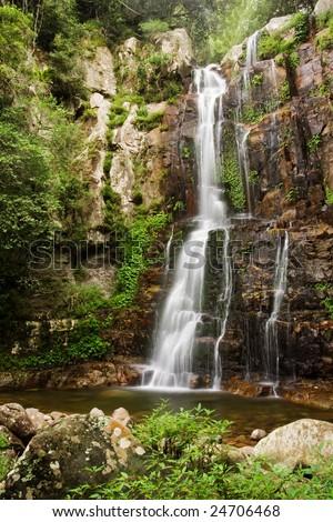 Beautiful misty waterfall, Minnamurra Falls in NSW, Australia - stock photo