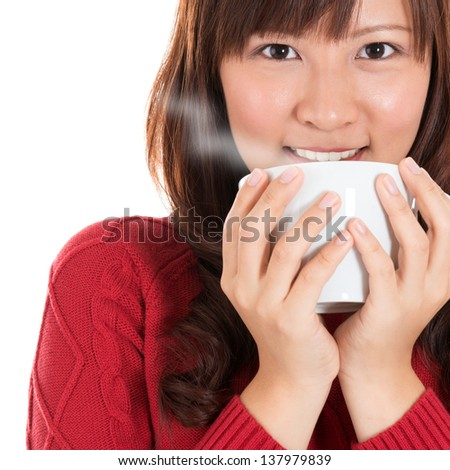 Beautiful mixed Chinese Asian young woman enjoying a cup of coffee, with coffee smoke and copy space on right, isolated on white background. - stock photo