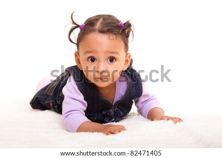 Beautiful mixed race baby lying on the floor - stock photo