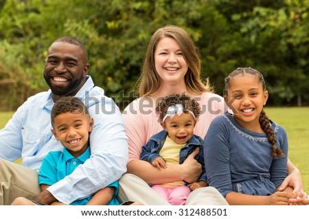 Beautiful mixed race family. Bi racial family. African American and Caucasian family. - stock photo