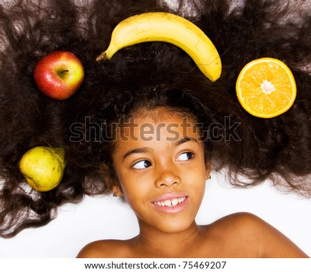 beautiful mixed race girl with fruits - stock photo