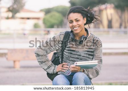 Beautiful Mixed-Race Student Outdoor - stock photo