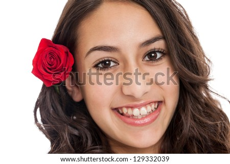 Beautiful mixed race tween girl smiling portrait with red rose in hair isolated on a white background - stock photo