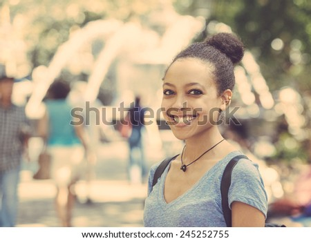 Beautiful Mixed-Race Young Woman in the City, Smiling Portrait - stock photo