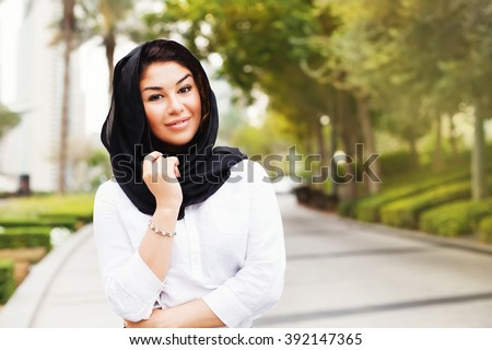 beautiful mixed raced muslim woman on a street of Dubai city - stock photo