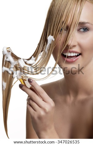 beautiful model comb wet hair  after washing on white - stock photo