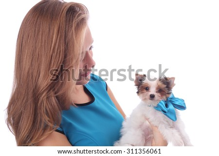 beautiful model girl wearing blue dress with the cute little beaver puppy
