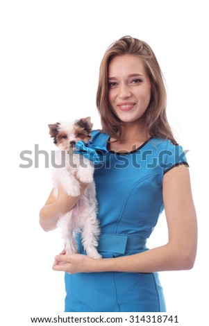 beautiful model girl wearing blue dress with the cute little beaver puppy - stock photo