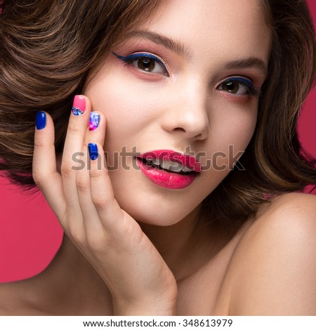 Beautiful model girl with bright pink makeup and colored  nail polish. Beauty face. Short colorful nails