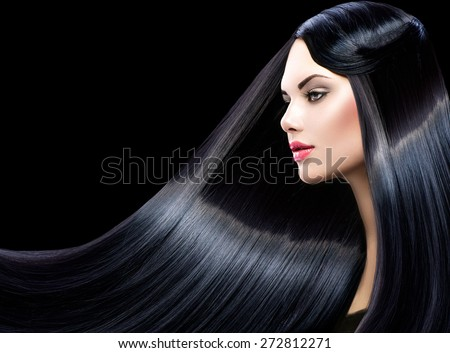 Beautiful model girl with healthy long straight shiny hair isolated on black background. Hair. Healthy Long Black Hair. Beauty Brunette Woman. Gorgeous Hair - stock photo