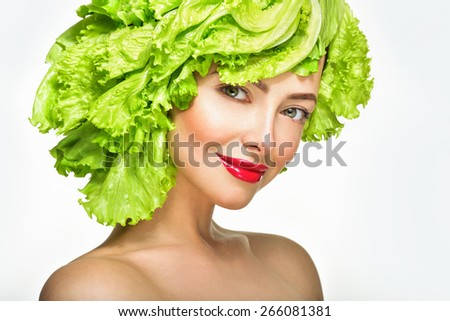 Beautiful model girl with Lettuce hair style.  Healthy food concept, diet, vegetarian food. - stock photo