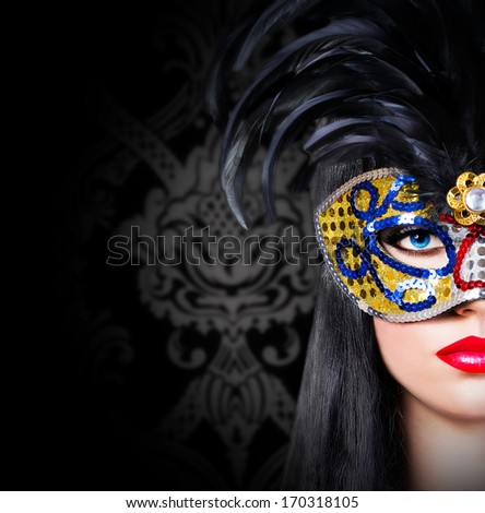 Beautiful model in carnival mask with red lips - stock photo