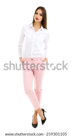 Beautiful model in white shirt and pink pats isolated on white - stock photo