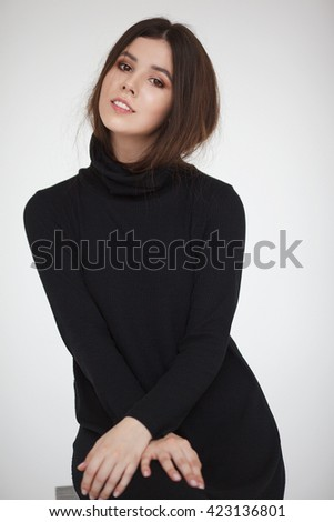 Beautiful model lady with natural make-up and brunette hair. Studio fashion shot on white background. Perfect skin.
