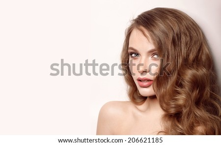 beautiful model lady with natural make-up and brunette hair studio fashion shot on white background, perfect skin