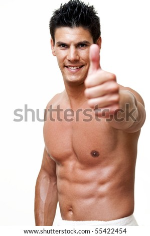 beautiful model photographed with the thumbs up - stock photo