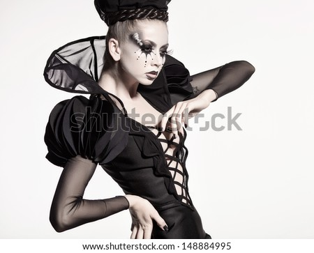beautiful model posing as chess queen - fantasy make-up - stock photo