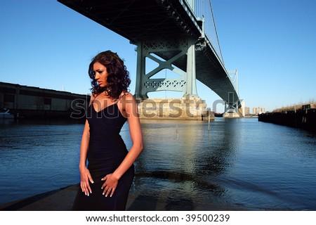 Beautiful model posing by Ben Franklin Bridge in Philadelphia - stock photo