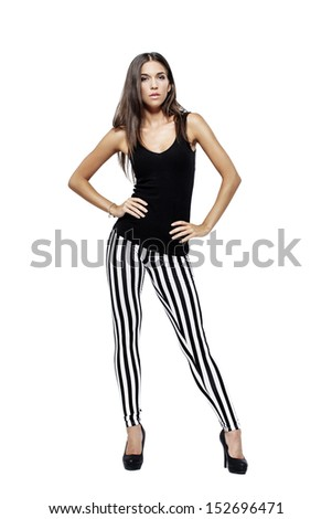 Beautiful model posing on white, hands on waist, isolated - stock photo